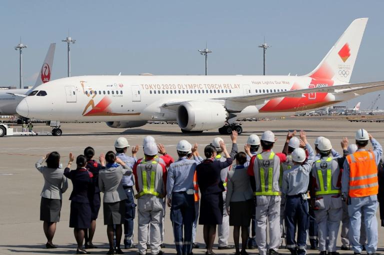 Un avión parte del aeropuerto Haneda de Tokio el 18 de marzo de 2020 rumbo a Grecia para recoger la llama olímpica.