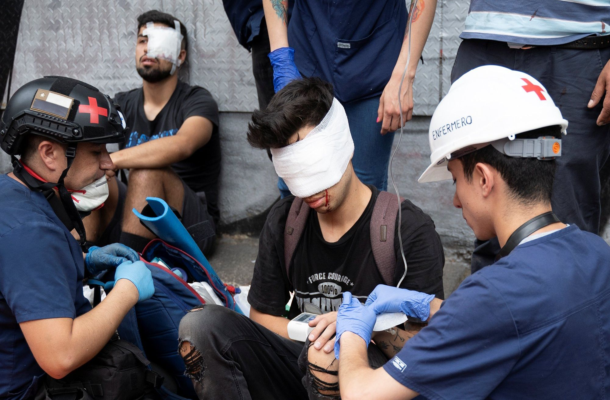 Chilean student Gustavo Gatica receive first aid care after being shot in the face by Chilean police with rubber bullets during a protests in Santiago, Chile November 8, 2019. Picture taken November 8, 2019. REUTERS/Osvaldo Pereira NO RESALES NO ARCHIVE
