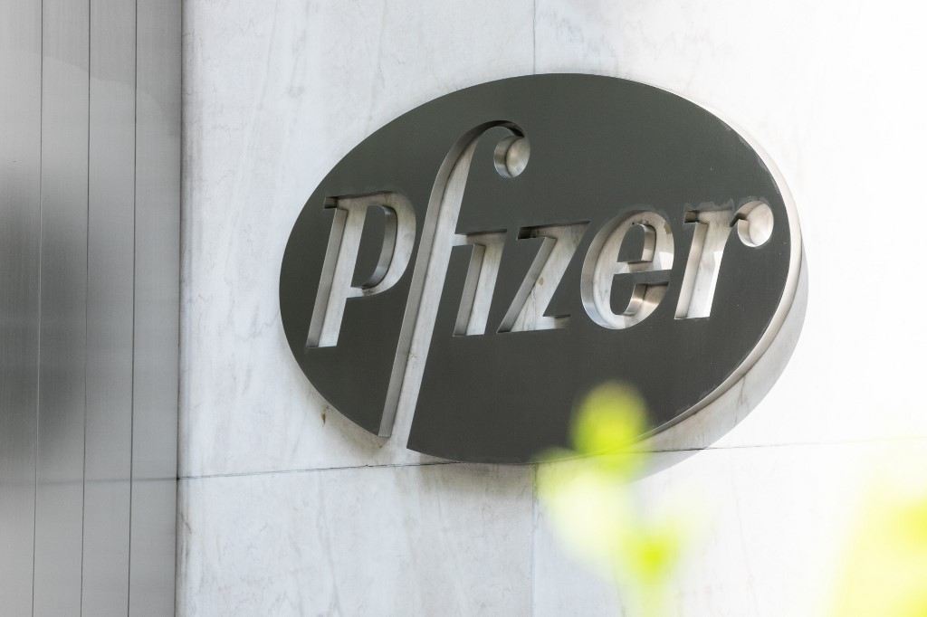 NEW YORK, NY - JULY 22: Pfizer Inc. signage is seen on July 22, 2020 in New York City. Pfizer and German biotechnology firm BioNTech have agreed to supply the U.S. government with 100 million doses of coronavirus vaccine under a $1.95 billion deal.   Jeenah Moon/Getty Images/AFP