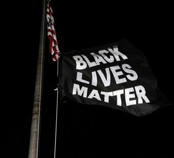 Protesters hang a Black Lives Matter Flag at Florissant Police department during a protest against the police brutality of a man hit by a Florissant detective and the death in Minneapolis police custody of George Floyd, in Florissant, Missouri, U.S. June 10, 2020. REUTERS/Lawrence Bryant