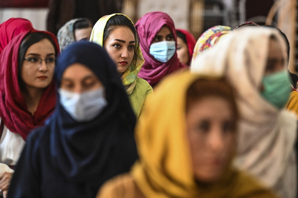 Afghan women take part in a gathering at a hall in Kabul on August 2, 2021 against the claimed human rights violations on women by the Taliban regime in Afghanistan. (Photo by SAJJAD HUSSAIN / AFP)