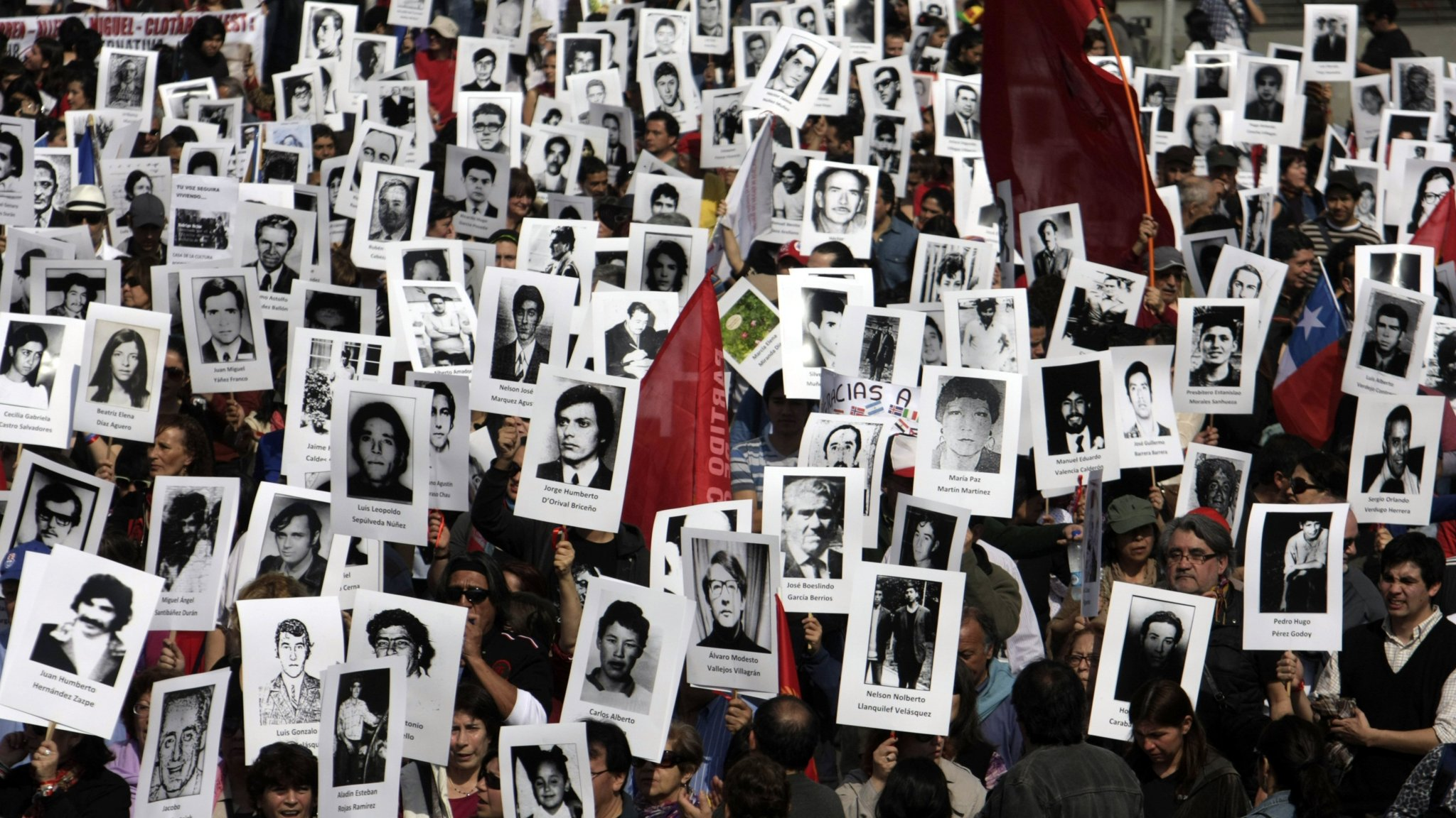 """Activists of the Chilean Human Rights organization """"Detained and Disappeared People"""" take part in a demonstration in Santiago on September 8, 2013, in remembrance of late President (1970-1973) Salvador Allende, who died on September 11, 1973 during the military coup d'etat led by general Augusto Pinochet. On September 11 Chile will commemorate the 40th anniversary of the coup that toppled Salvador Allende and brought dictator Pinochet to power. AFP PHOTO/Sebastian Silva        (Photo credit should read Sebastian Silva/AFP/Getty Images)"""