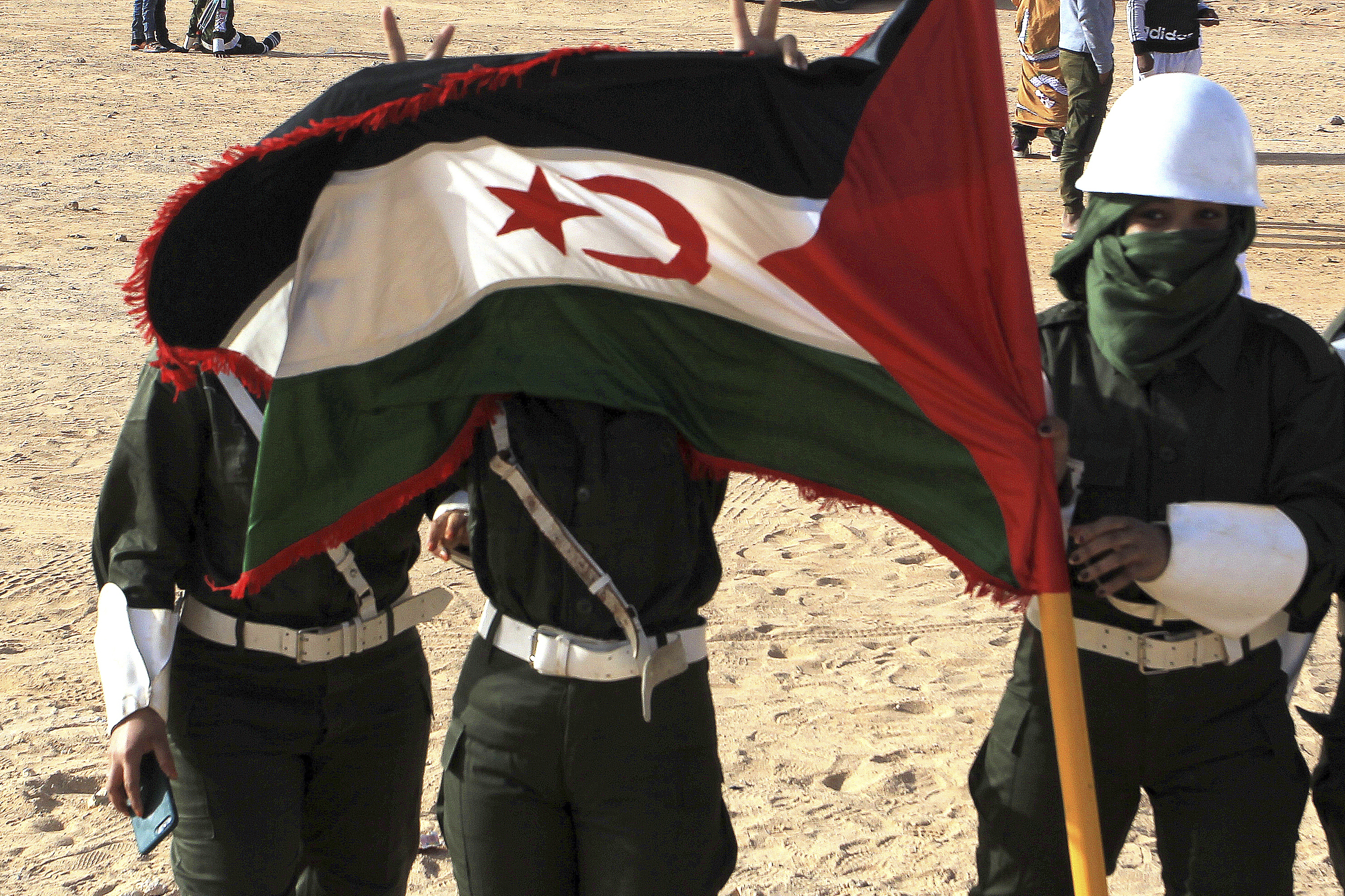 Female soldiers of the Sahrawi Arab Democratic Republic (SARD) parade during celebrations marking the 45th anniversary of the creation of the SARD Saturday, Feb.27 2021 near Tindouf, southern Algeria. The United Nations sought a settlement of the conflict in Western Sahara after Spain's withdrawal in 1976 from the territory, claimed by both Morocco and by the SADR. (AP Photo/Fateh Guidoum)