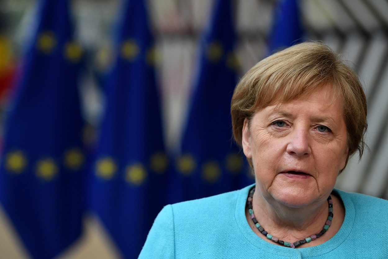 Germany's Chancellor Angela Merkel addresses media representatives as she arrives on the first day of a European Union (EU) summit at The European Council Building in Brussels on June 24, 2021. - . (Photo by JOHN THYS / various sources / AFP)